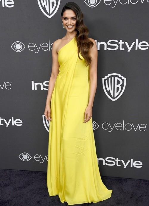 Deepika Padukone in a yellow one shoulder Ralph Lauren gown at the Golden Globe Awards 2017. - SeenIt