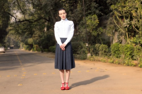 Help me with this outfit!! white shirt with navy polka dot pleated midi skirt.. - SeenIt