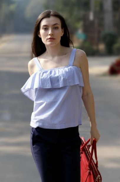 Blue and white stripe ruffled top..Find me this! - SeenIt