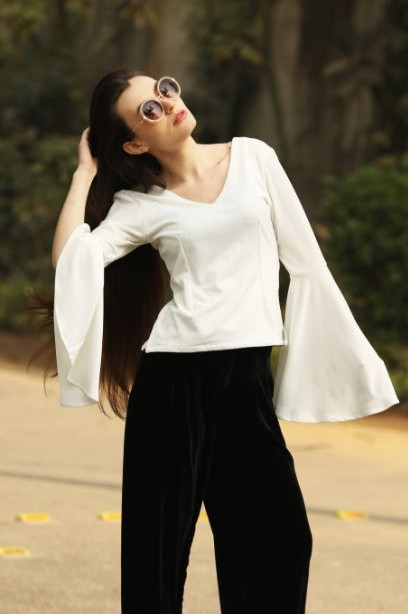 Bell sleeves are so in trend!! Get me this white v neck top with bell sleeves. - SeenIt