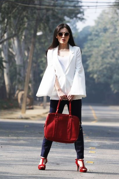 Who wouldn't want to wear such a clean cut white cape blazer!! - SeenIt