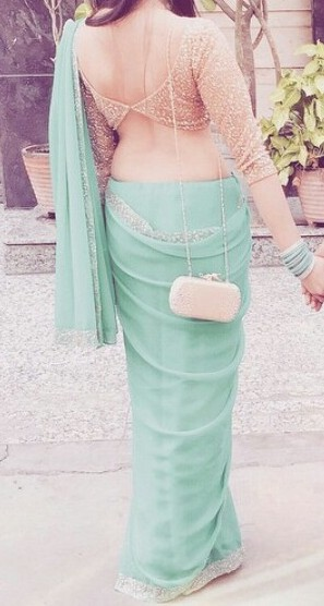 need similar saree in light blue/ sky blue and similar blouse and clutch - SeenIt