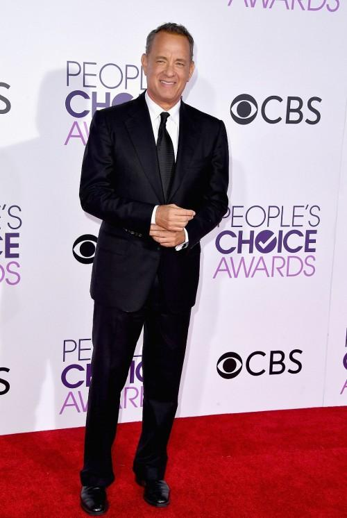 Tom Hanks attended the People's Choice Awards 2017 in a black formal suit. - SeenIt