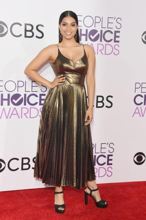 Sizzling hot Lilly Singh in golden metallic pleated dress at the People's Choice Awards 2017. - SeenIt
