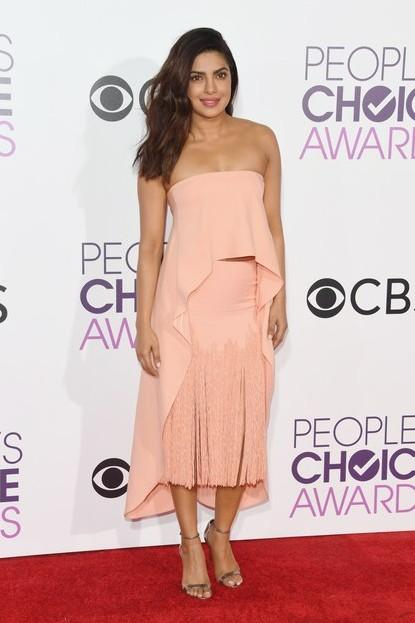 Priyanka slaying this peach tassel dress by Sally LaPointe at the People's Choice Awards 2017. - SeenIt