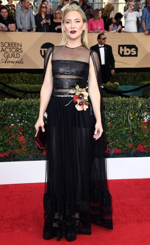 Kate Hudson in a black sheer gown with cape style sleeves at the SAG Awards 2017. - SeenIt