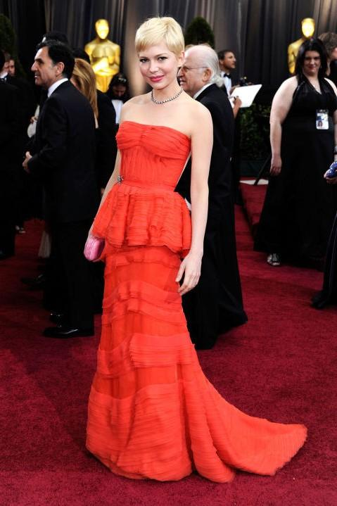Michelle Williams in Louis Vuitton red peplum gown at the Oscars 2012. - SeenIt