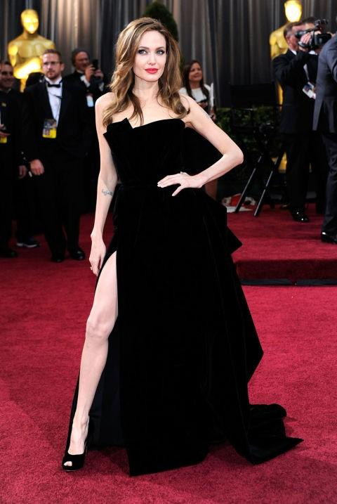 Angelina Jolie in Atelier Versace black slit gown at the Oscars 2012. - SeenIt