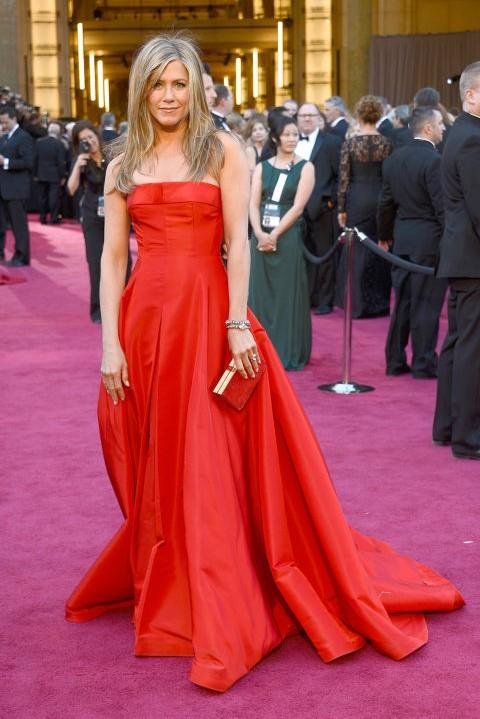 Jennifer Aniston in Valentino Haute Couture red strapless gown at the Oscars 2013. - SeenIt