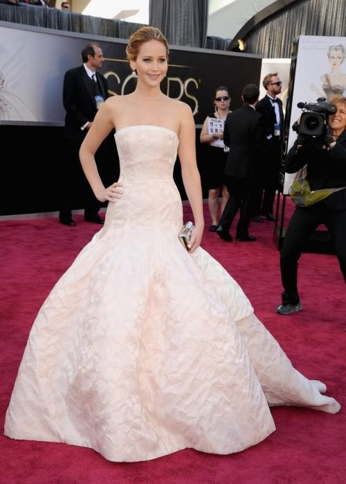 Jennifer Lawrence in Christian Dior Haute Couture pink strapless gown at the Oscars 2013. - SeenIt