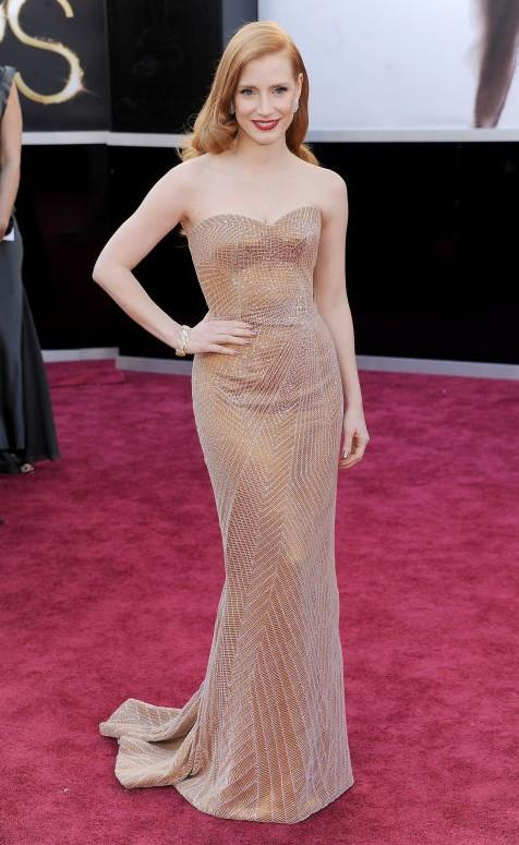Jessica Chastain in Armani Prive beige strapless embellished gown at the Oscars 2013. - SeenIt