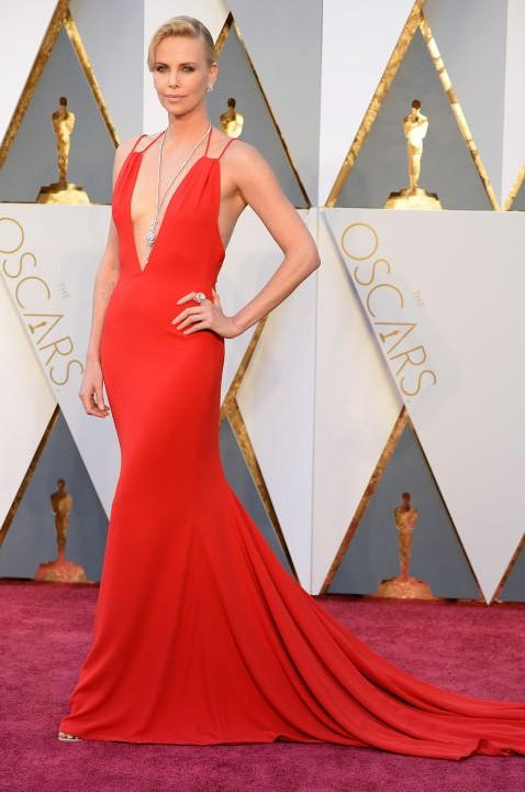 Charlize Theron in Christian Dior red gown at the Oscars 2016. - SeenIt