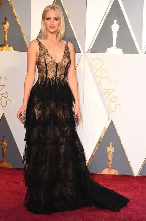 Jennifer Lawrence in Christian Dior Haute Couture black lace gown at the Oscars 2016. - SeenIt