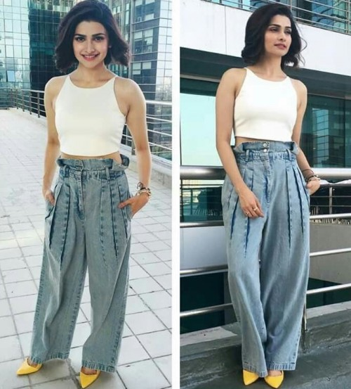 Whats your view on Prachi's chic look in white crop top, denim flared pants & yellow pumps.. - SeenIt