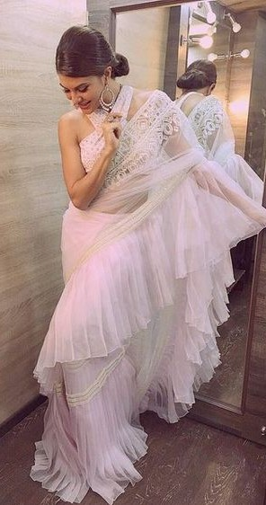 Jacqueline is setting the ruffled saree trend straight from the green room of an award show. - SeenIt