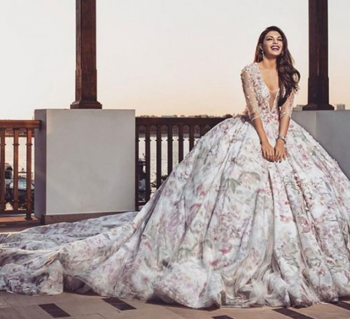 Isn't Jacqueline looking gorgeous in that white floral gown?? - SeenIt