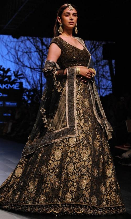 Yay or Nay? Aditi Rao Hyadri walked the ramp as a showstopper for the House of Kotwara in a glittering black encrusted lehenga at the Lakme Fashion Week - SeenIt