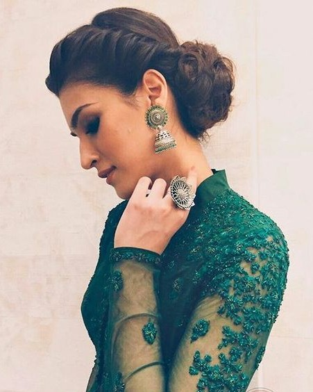 Similar to the silver jhumka that Kriti Sanon is wearing. - SeenIt