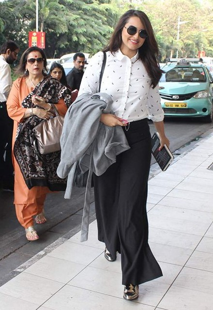Something similar to these black palazzo pants that Sonakshi Sinha was wearing at the airport. - SeenIt