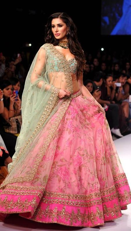 What do you think of the designer pink lehenga that Nargis Fakhri is wearing - SeenIt