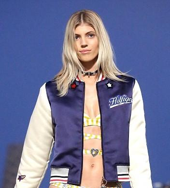 Looking for the navy blue and white bomber baseball jacket that Devon Windsor is wearing.. - SeenIt