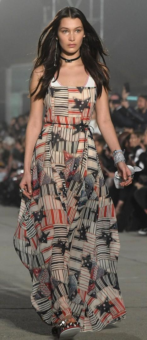 What do you think of this beige, red, black striped and start print maxi dress that Bella Hadid is wearing? - SeenIt