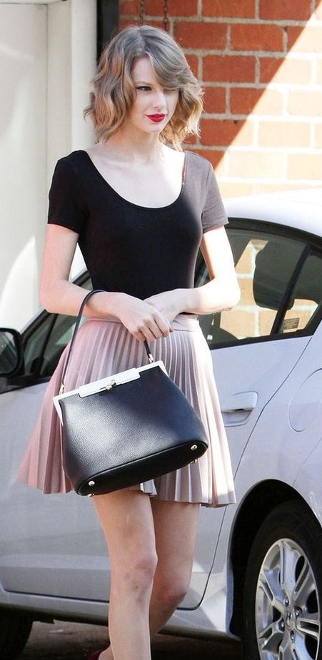 Want a similar black top that Taylor Swift is wearing. - SeenIt