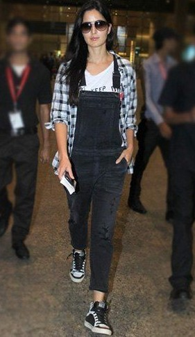 Want something similar to the outfit that Katrina Kaif is wearing. The way she paired a black dungaree with a white and black checkered shirt. - SeenIt
