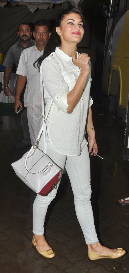 Need something similar to the white shirt and jeans that Jacqueline Fernandez is wearing. - SeenIt