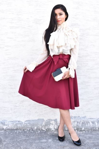 This beautiful white top with lots of frills and the maroon midi skirt with bow are the products that I am looking for. - SeenIt