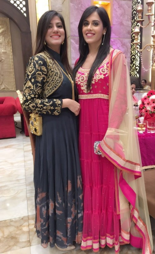 Looking for the black anarkali with golden embroidery and the magenta embellished one for my friend's wedding. - SeenIt