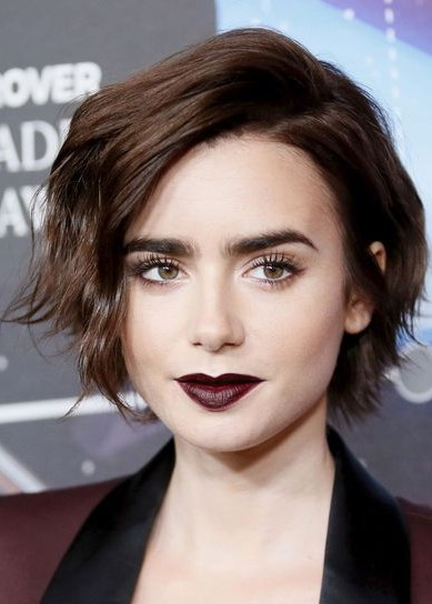 Where can I find a similar deep maroon color lipstick that Lily Collins is wearing? - SeenIt