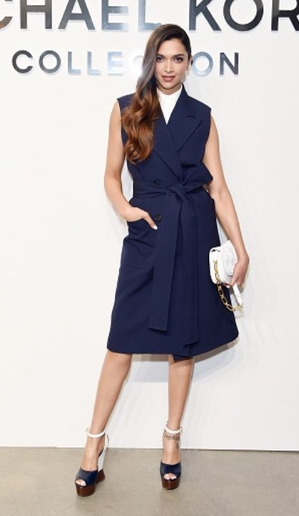 Yay or Nay? Deepika Padukone wearing a  Michael Kors navy blue trench dress at the New York Fashion Week - SeenIt