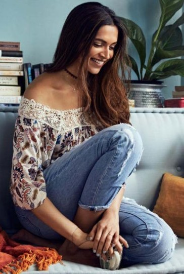 Want the similar white floral top and blue jeans that Deepika Padukone is wearing - SeenIt