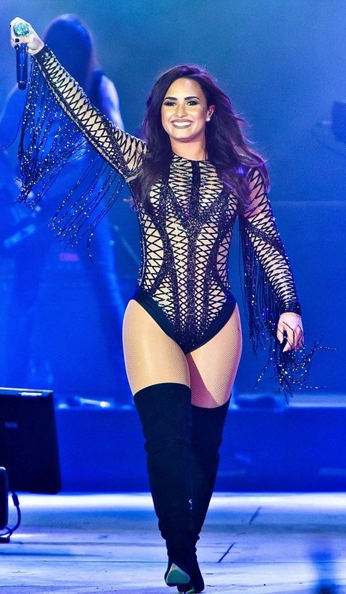 Yay or Nay? Demi Lovato performed in a meshy bodysuit paired with thigh high boots. - SeenIt