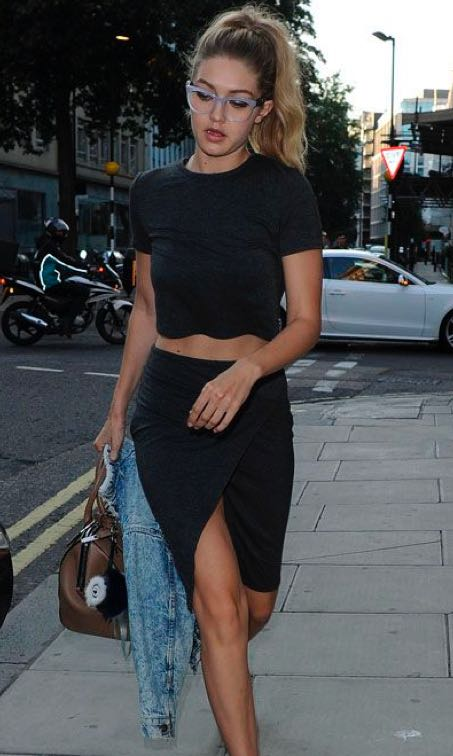 Want the black croptop, black wrap skirt and eyewear that Gigi Hadid is wearing - SeenIt