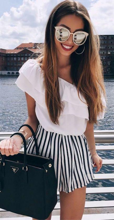 Want the oversized sunglasses, white ruffled top, black handbag and striped shorts - SeenIt