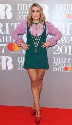 Yay or Nay? Talia Storm wearing a green mini dress with a pink ruffled top at the BRIT awards - SeenIt