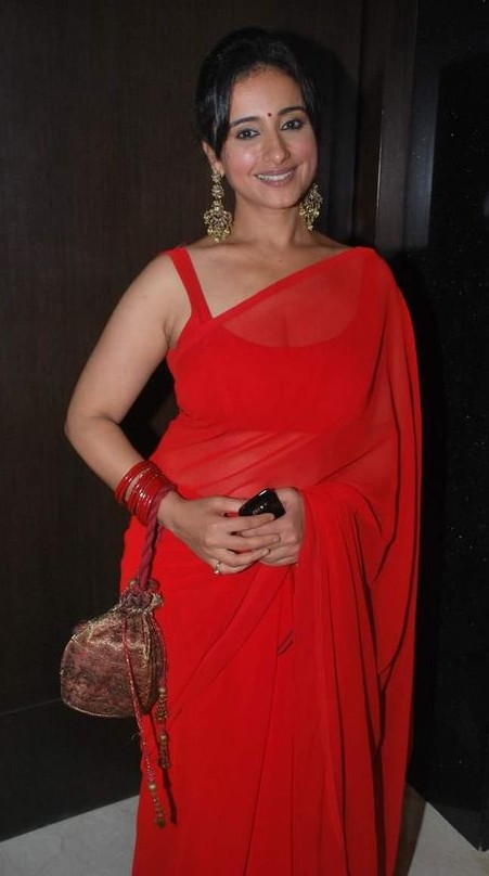 Looking for a similar plain red saree that Divya Dutta is wearing - SeenIt