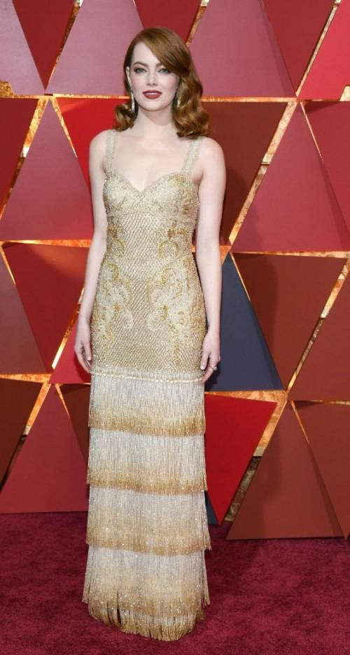 Yay or Nay? Emma Stone wearing a golden embellished Givenchy gown with a fringed bottom at the Oscars night - SeenIt