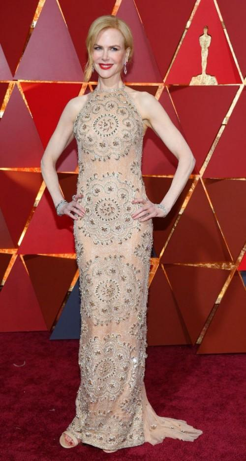 Yay or Nay? Nicole Kidman wearing a sheer golden Armani Prive gown at the Oscars night - SeenIt