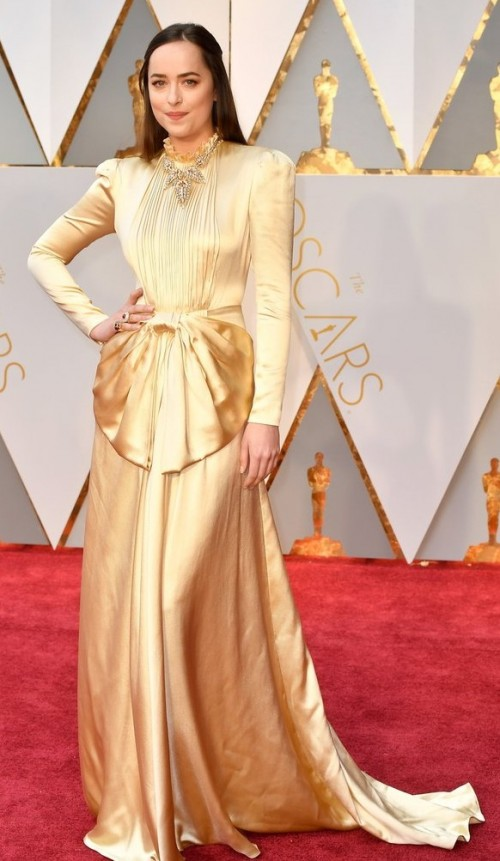 Yay or Nay? Dakota Johnson in a gold Gucci outfit at the Oscars night - SeenIt