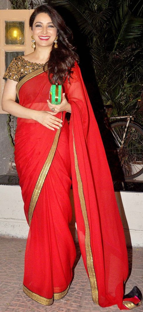 Want similar red saree that Tisca Chopra is wearing - SeenIt