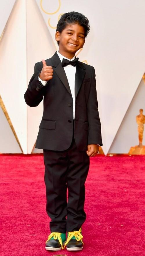 Yay or Nay? Sunny Pawar wearing a black tuxedo at the Oscars red carpet last night - SeenIt