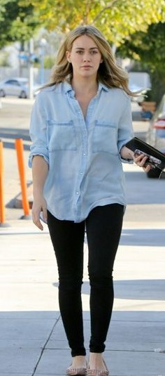 Looking for this light blue shirt and the black pants that Hilary Duff is wearing - SeenIt
