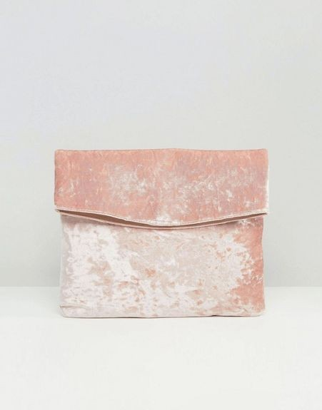 This pink velvet clutch is what I am looking for. - SeenIt