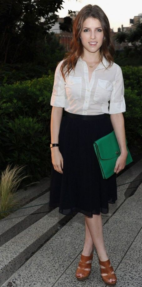 Looking for the entire outfit that Anna Kendrick is wearing....The white shirt, navy blue midi skirt and green envelope clutch. - SeenIt