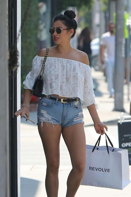 99d43db8954923 Want this summer outfit that Shay Mitchell is wearing. White off-shoulder  crop top