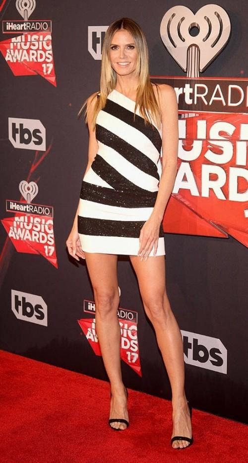 Yay or Nay? Heidi Klum wearing a black and white shimmer striped shirt dress at the iHeart Radio music awards - SeenIt