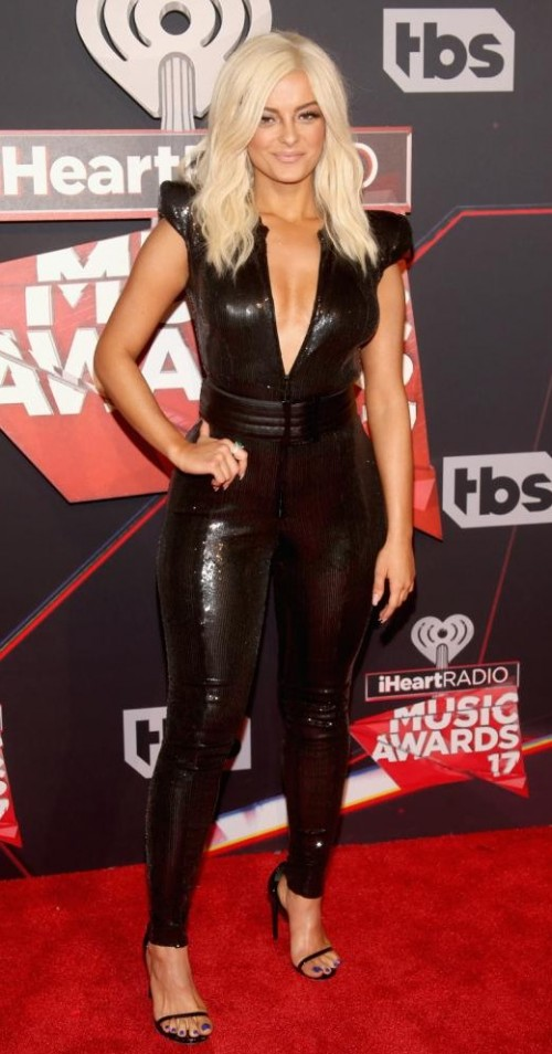 Yay or Nay? Bebe Rexha wearing a shimmer black plunging jumpsuit at the iHeart Radio music awards - SeenIt